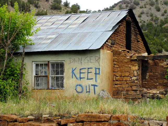 "I saw several ruins that were marked in this fashion. I don't know if ""Keep Out"" is a warning of concern for the safety of trespassers, or an expression of privacy."