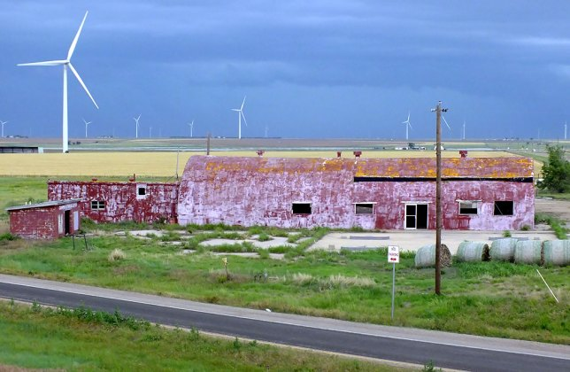 Abby made this image of the approaching thunderstorm in Groom, Texas, featuring the fading red quonset hut I have been photographing for over a decade.
