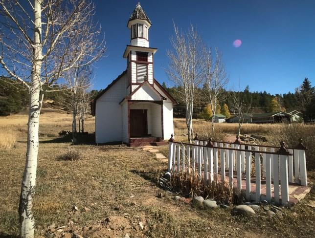 I don't know the story behind this handsome little church just a few blocks south of downtown Pagosa Springs. There were no signs, and the internet wasn't much help. If you look closely, you can see a family of deer in the shade just to the left of the church.