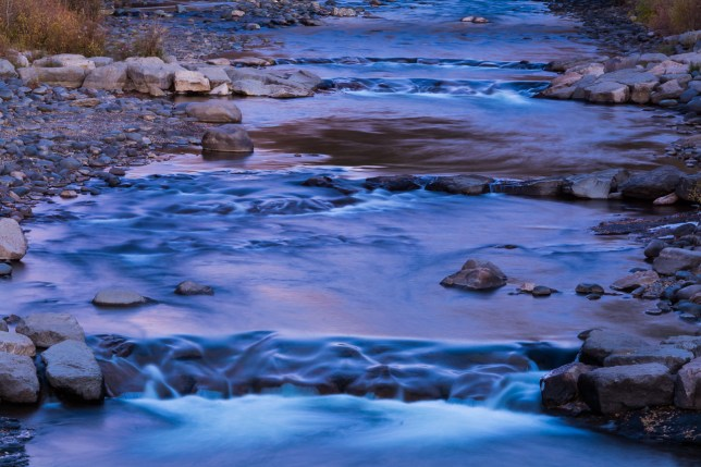The San Juan River in Pagosa Springs, Colorado takes on a deep blue-purple hue in this 30-second exposure made right after dusk.