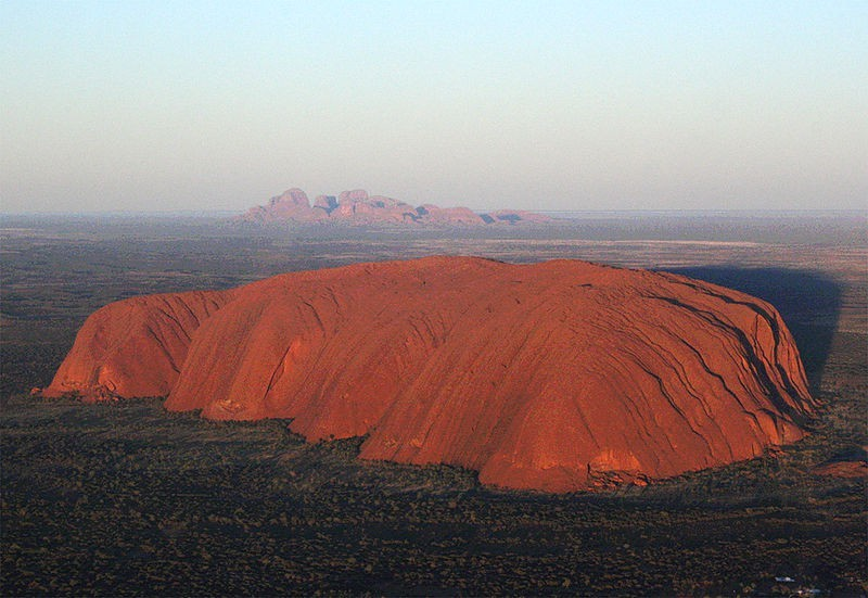 Uluru originally known as Ayers Rock with the Olgas in the background