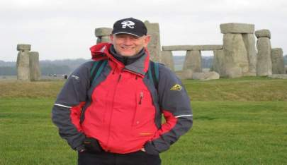 Richard exploring Stonehenge England as part of world trip with family