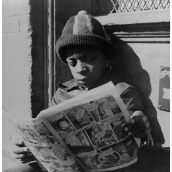 Young man reading a comic book.