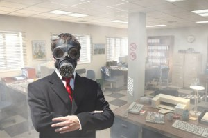 Man in gas mask standing in office.