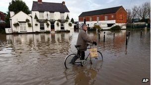 Floods in UK: Travel disrupted as storms head north