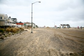 Ocean Ave is covered with tons of sand. It'll take bulldozers a week to clear this street.