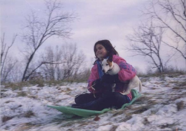 Claire, 11, and Jack, .9, sledding at our farm in January 1998