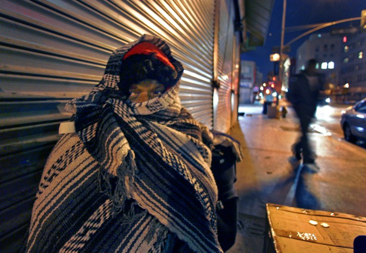 Emma (she wouldn't give her last name) peers out from underneath a blanket as she tries to keep warm along Los Angeles Street at 8th Street in Skid Row late Thursday in Los Angeles December 20, 2006. For a story on how the homeless suffer during the cold weather. She's originally from Kansas City and she says she been in L.A. about three years.