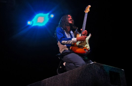 Guitarist John Frusciante jams from atop of an amplifier during the Red Hot Chili Peppers concert, Saturday night at the Forum.