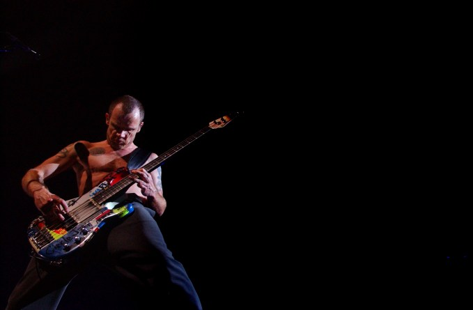 Bass player Flea jams during the Red Hot Chili Peppers concert, Saturday night at the Forum.