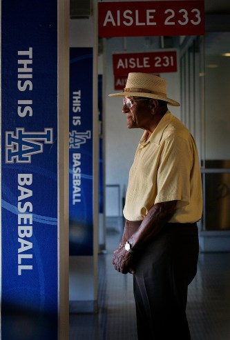 Dodger pitching great Don Newcombe at Dodger Stadium, Friday in L.A. Plaschke writes about what Newcombe experienced with teammates, the opposition and fans when he played in the 1950's. The 1955 World Series team will be honored at Sunday's game.