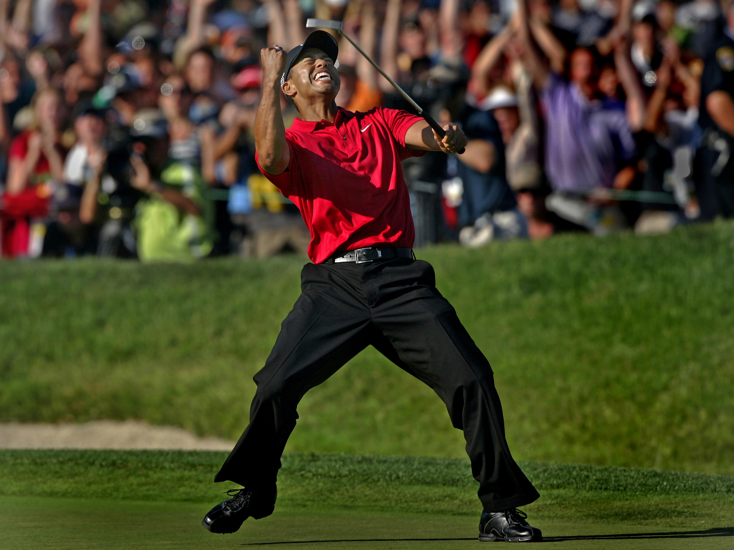 LA JOLLA, CA - JUNE 15, 2008: Tiger Woods celebrates on the eighteenth green after sinking a putt for a birdie and to force a playoff with Rocco Mediate during the final round of the U.S. Open at Torrey Pines in La Jolla of June 15, 2008. (Richard Hartog/ Los Angeles Times)