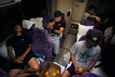 It's only a short ride (15 mins.), but it was a long day after playing a double-header vs. the Fullerton Flyers, as the Japan Samurai Bears of the independent Golden League take a bus back to their hotel, late Tuesday night. They are the first all-Japanese team to participate in an American sports league. They are in the midst of a grueling stretch of 90 games in 96 days in which they are living out of cheap hotels and their team bus while traveling throughout California and Arizona to play the other teams in the new startup league.