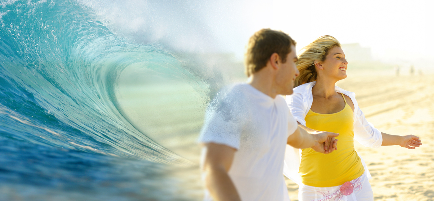 Young couple running on the beach overlayed with a giant cresting wave