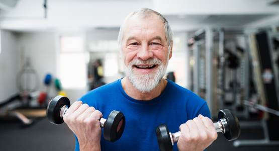 Older bearded patient exercising