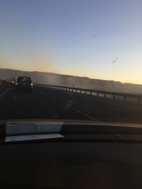 Smoke from the cavern below crawling across the roadway.