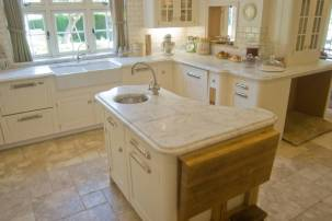 Counter and centre island in Bianco Carrara marble