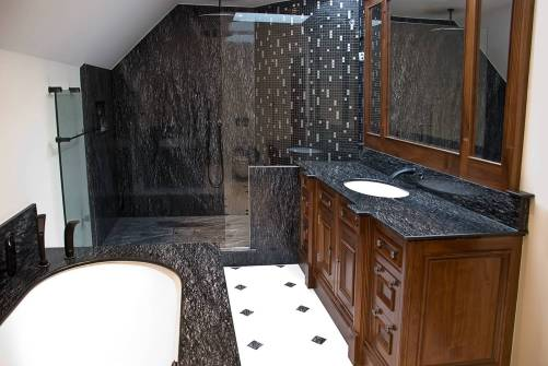 Full bathroom - shower, ball surround, basin top and flooring