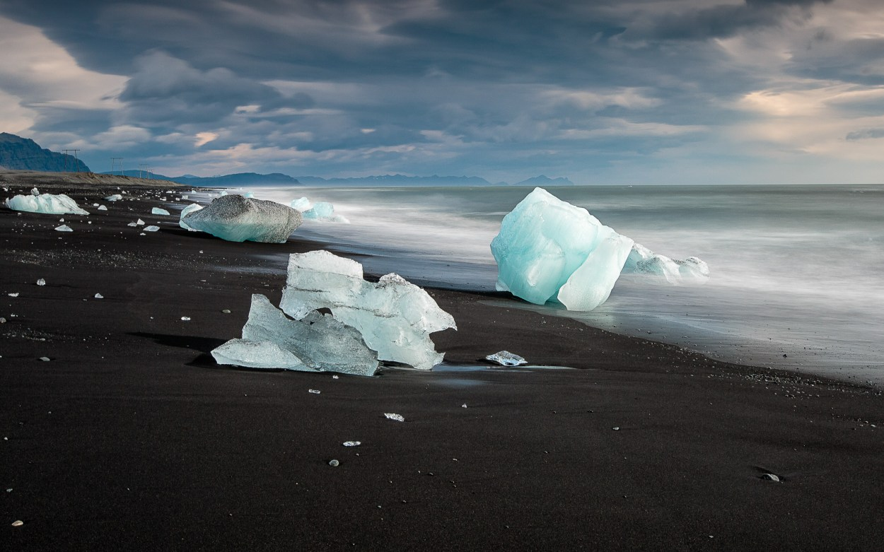 the black sands and icebergd on jokulsarlon beach