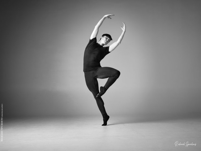 Dance Photographer - Dance photography - monochrome image of male dancer making a dancer single point shape