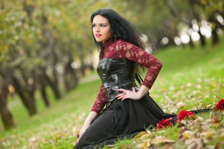 sitting woman with black corset