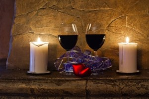 Red wine and candles on mantle
