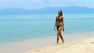 beach walking in a bikini