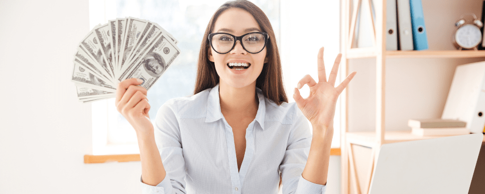 woman holding money in an office