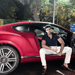Aneesh Gupta in his Bentley
