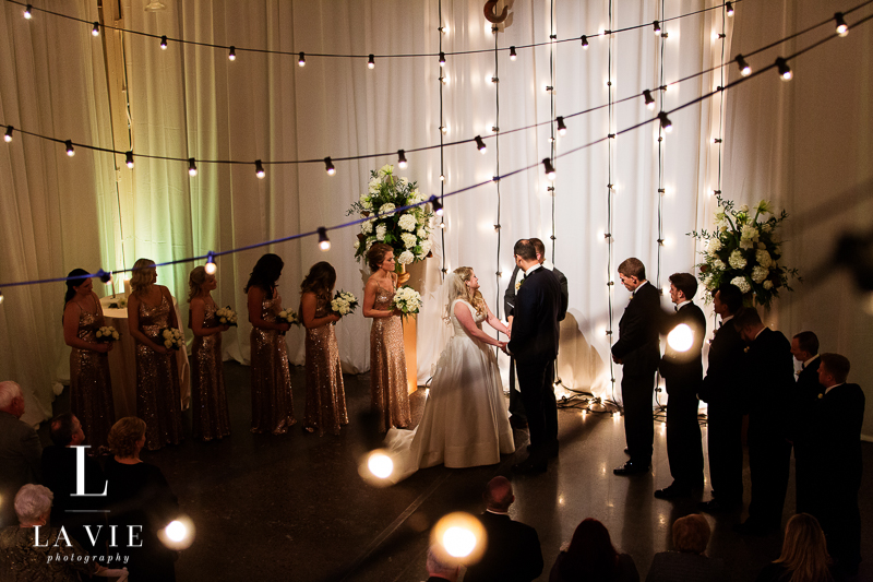 overhead view of wedding ceremony amidst cafe lights