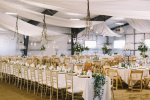 wedding reception tables with decor and draping