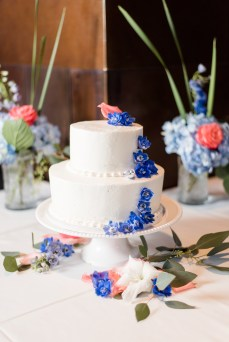 wedding cake with delphinium and roses