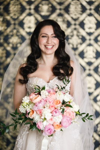 pastel wedding bouquet with smiling bride