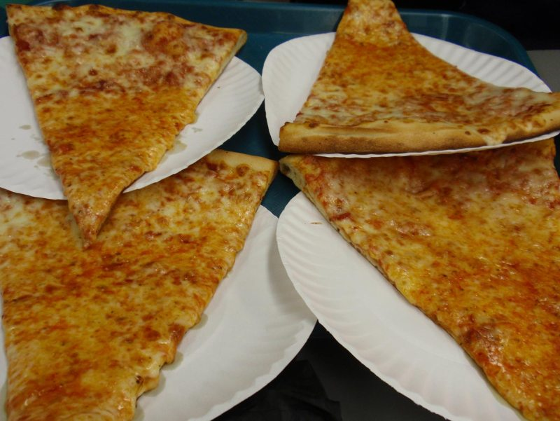 Four slices of cheesy pizza