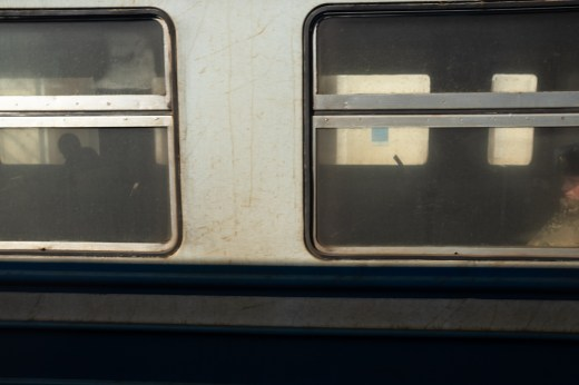 Train in Belarus, a military behind right window