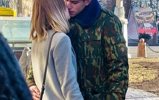 Military and his wife kissing