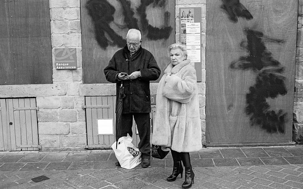 black and white picture of people in front of a bank