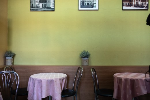 Belarusan snack, with yellow walls and pink tables