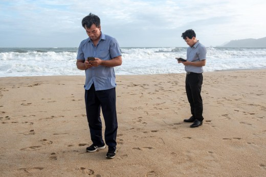 Salarymen on a beach