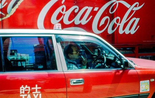 Taxi and Coca Cola truck in Hong Kong