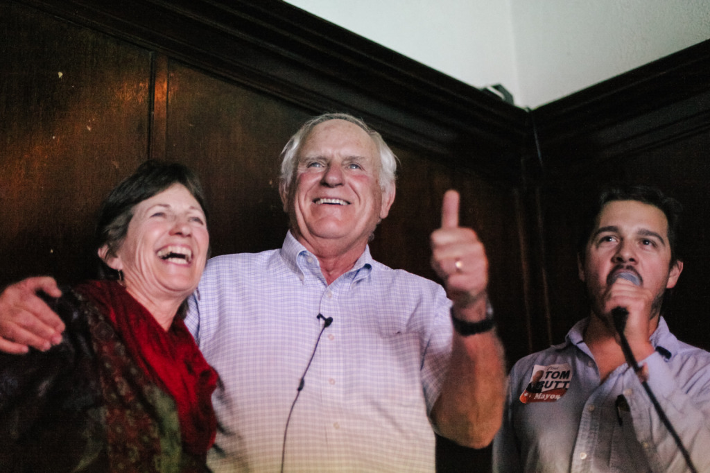 Tom Butt (center), with his wife and campaign manager, reacts as unofficial election results show him winning Richmond's mayoral seat. (Photo by Bonnie Chan)