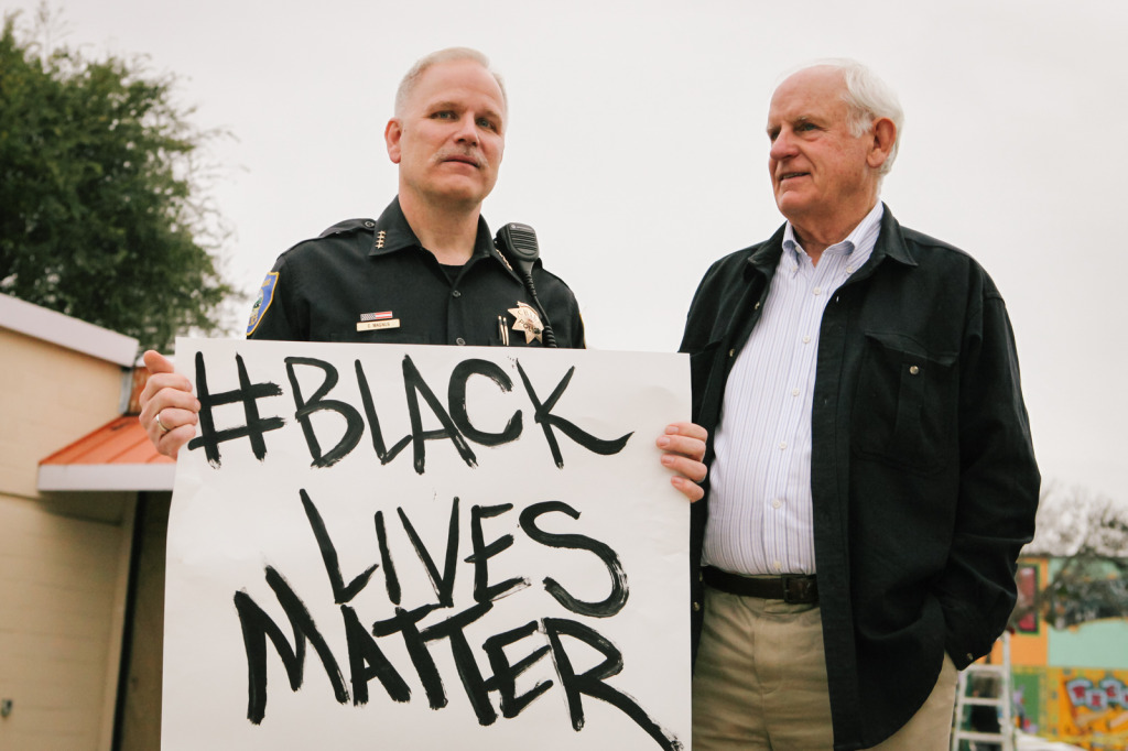 RPD Chief Chris Magnus, left, and Mayor-elect Tom Butt, right, showed support at a peaceful protest organized by the RYSE Center. (Photo by Bonnie Chan)