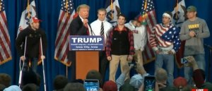 trump with members of the iowa wrestling team