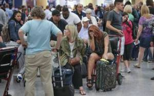 frustrated delta airlines passengers wait for their flights to be rescheduled