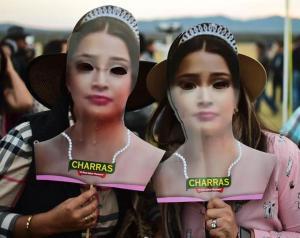 two partygoers wearing rubi masks