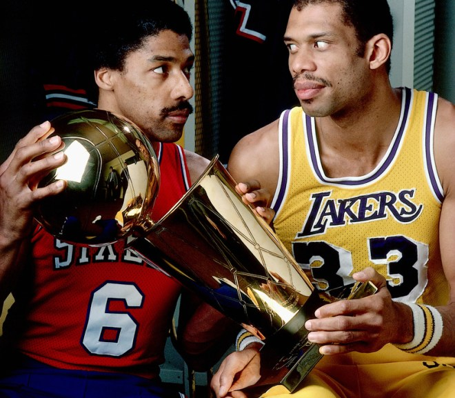 dr. j and kareem stare each other down over the nba finals trophy