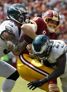 kirk cousins getting tackled by
