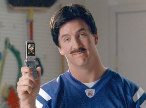 peyton manning with a moustache in a commercial for sprint