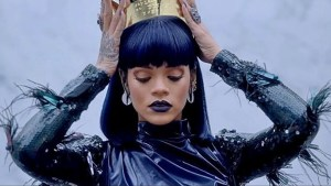 rihanna putting on a crown