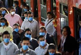 many metro riders in mexico city wearing masks to protect them from swine flu